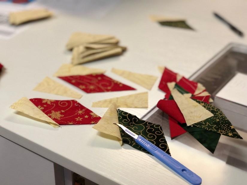 seam ripper beside pieced fabric units