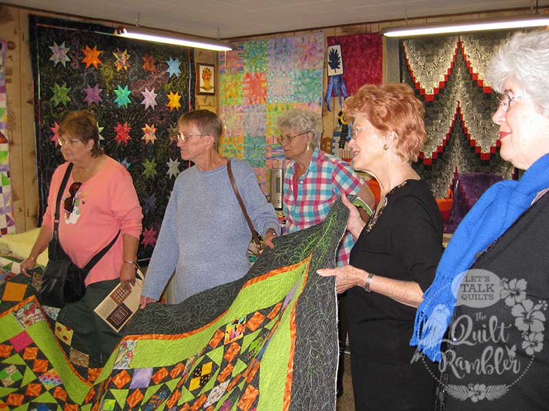 Quilters admire My Dangling Carrot quilt by Karen E Overton