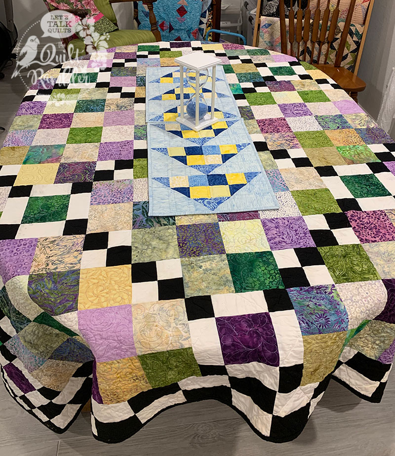 Quilts make great table covering especially Checking The Boxes quilt