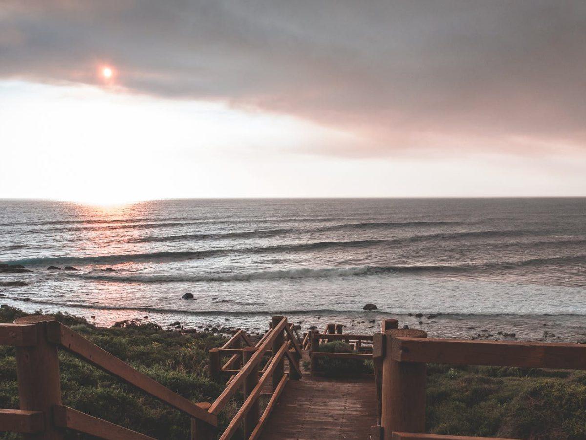 wooden boardwalk on picturesque evening seashore