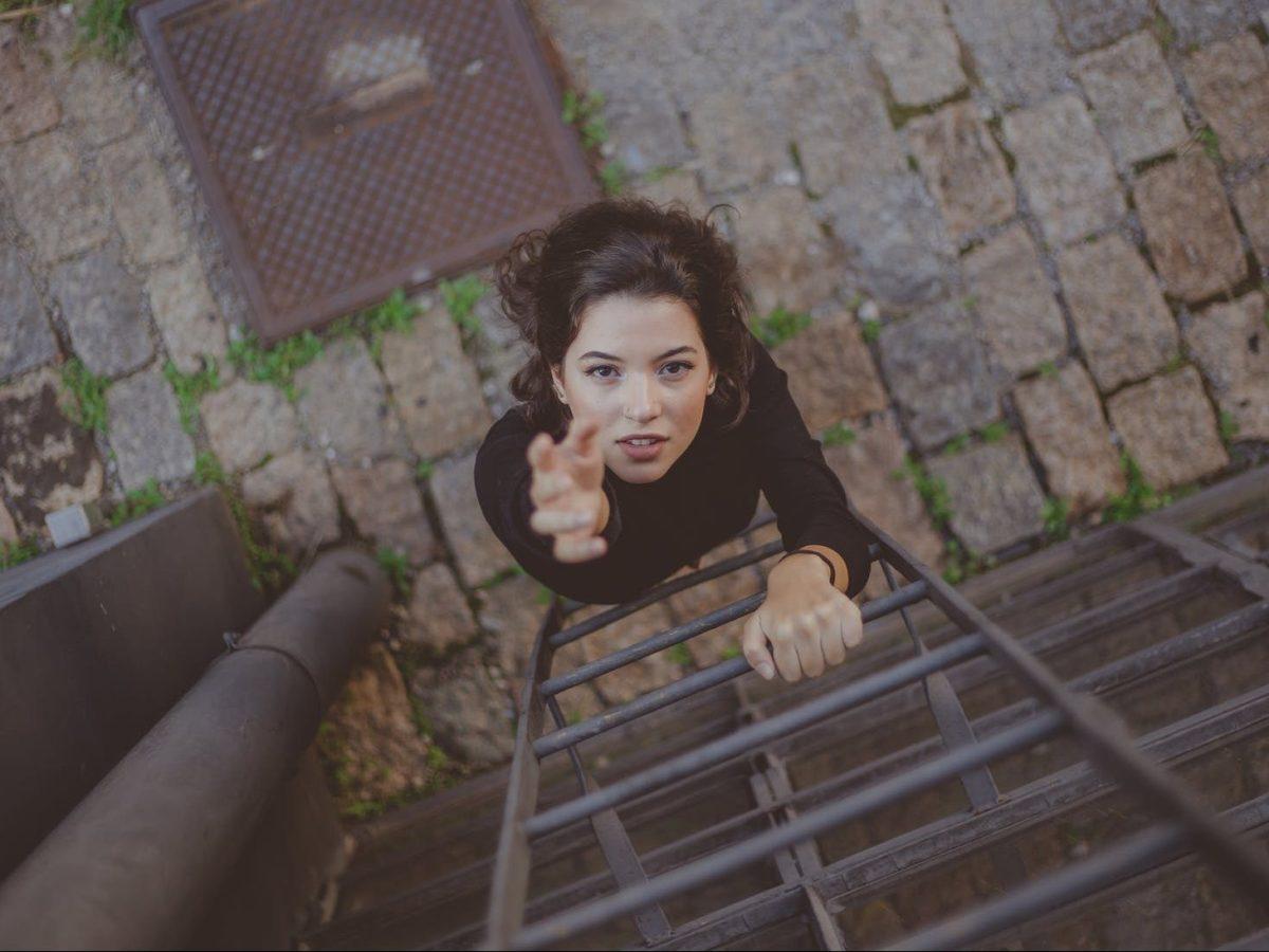 photo of woman climbing on ladder