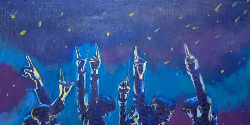 Members of BTS pointing their fingers skyward