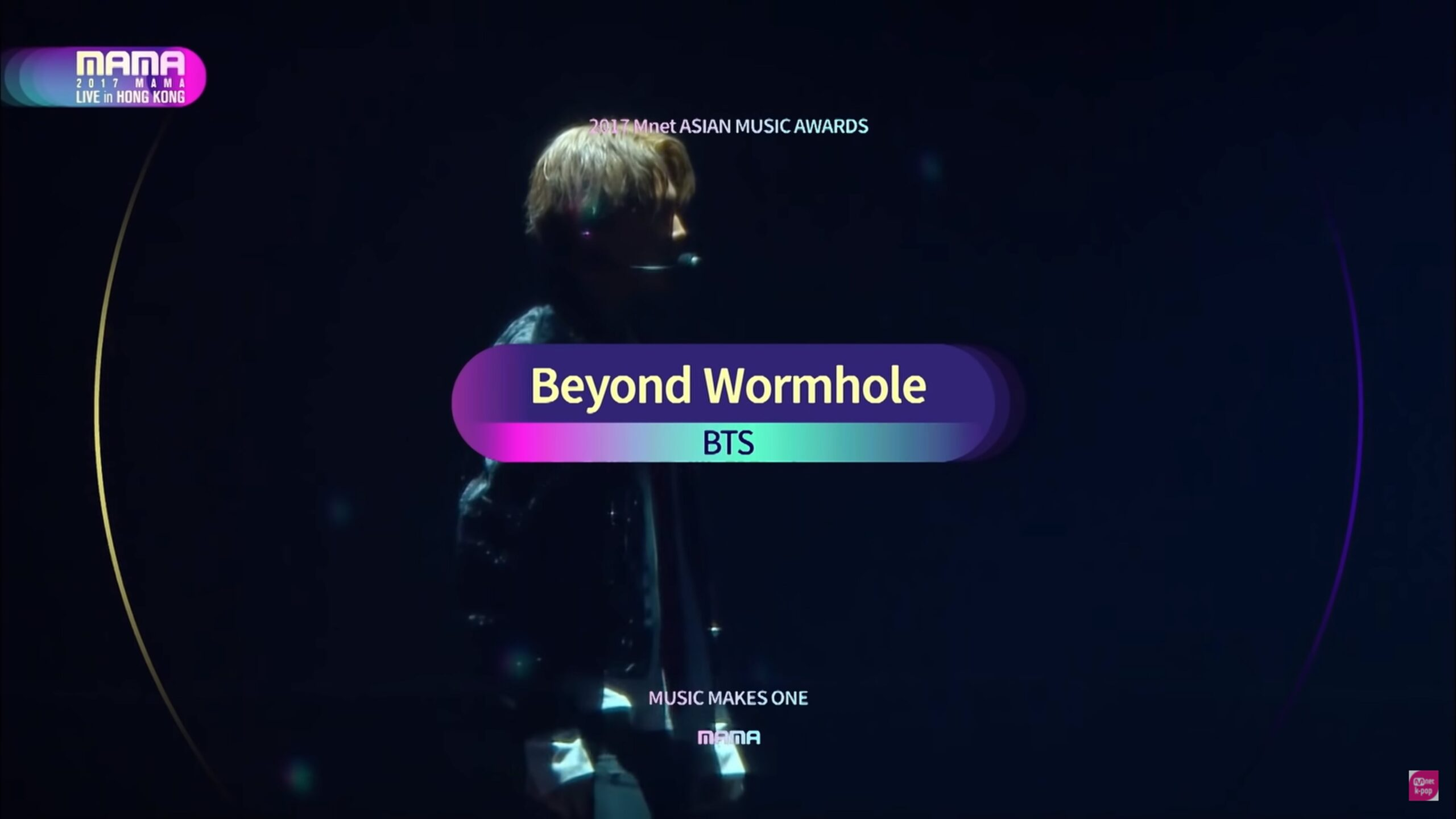 """BTS member pictured at 2017 MAMA behind the title of the performance labeled """"Beyond Wormhole"""""""