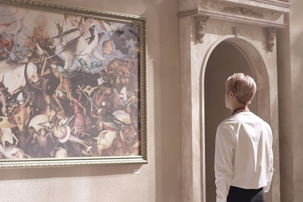 A teenage boy stands alone in a museum-like room observing a painting titled The Fall of the Rebel Angels