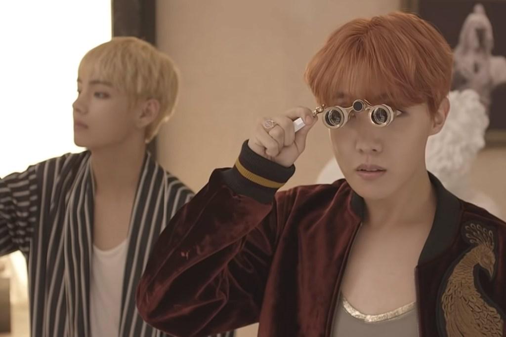 Taehyung and Hoseok play around in the museum-like room with binoculars.