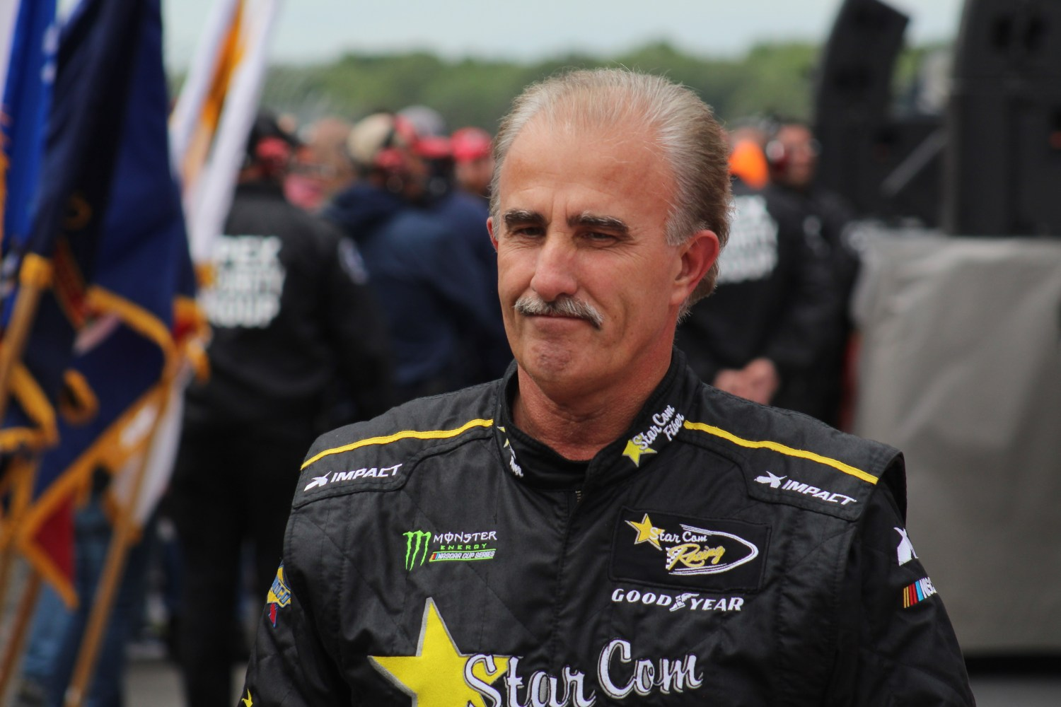 Derrike Cope walks during driver introductions ahead of the 2018 Pocono 400. (Tyler Head | The Racing Experts)