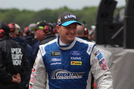 Michael McDowell walks during driver introductions for the 2018 Pocono 400. (Tyler Head | The Racing Experts)