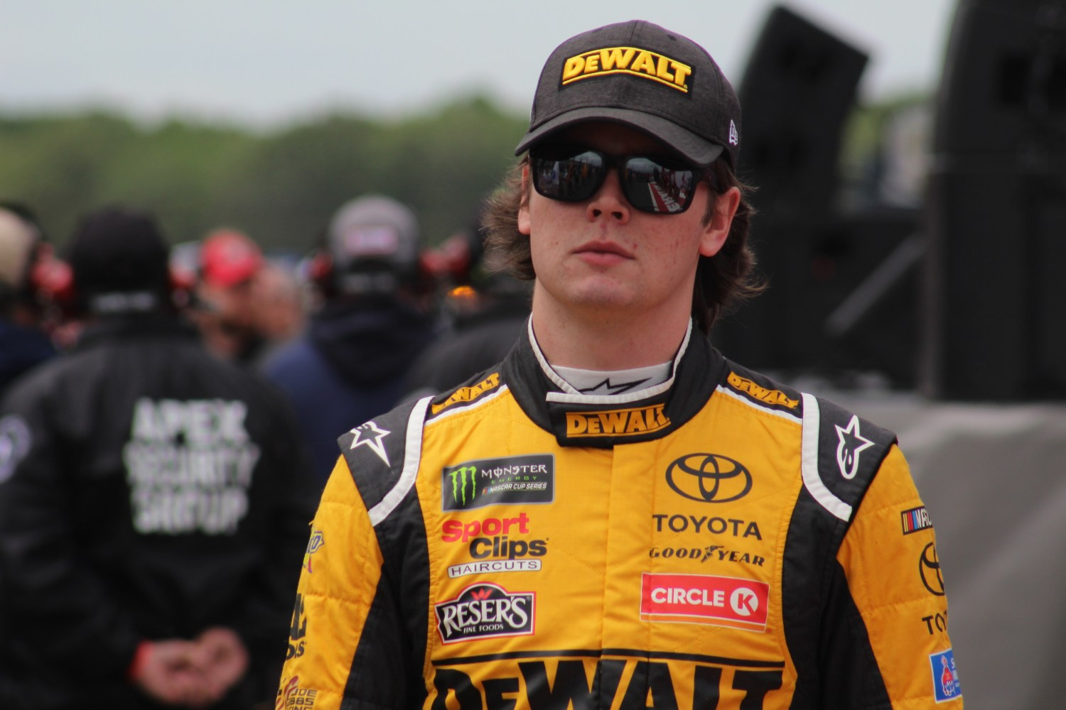 Erik Jones walks during driver introductions for the 2018 Pocono 400. (Tyler Head   The Racing Experts)