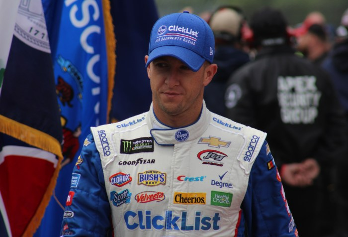 AJ Allmendinger walks during driver introductions for the 2018 Pocono 400. (Tyler Head   The Racing Experts)