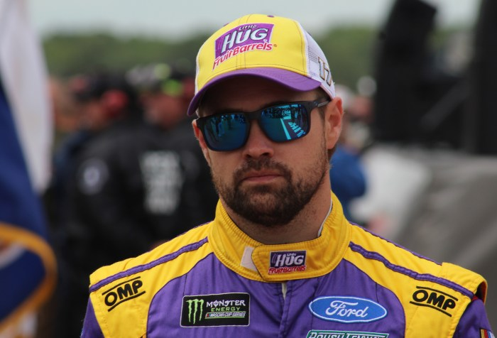 Ricky Stenhouse Jr. walks during driver introductions for the 2018 Pocono 400. (Tyler Head | The Racing Experts)