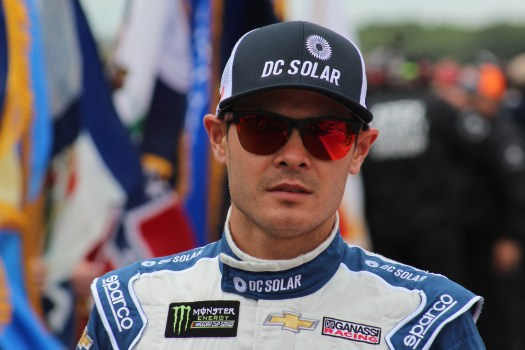 Kyle Larson walks during driver introductions for the 2018 Pocono 400. (Tyler Head | The Racing Experts)