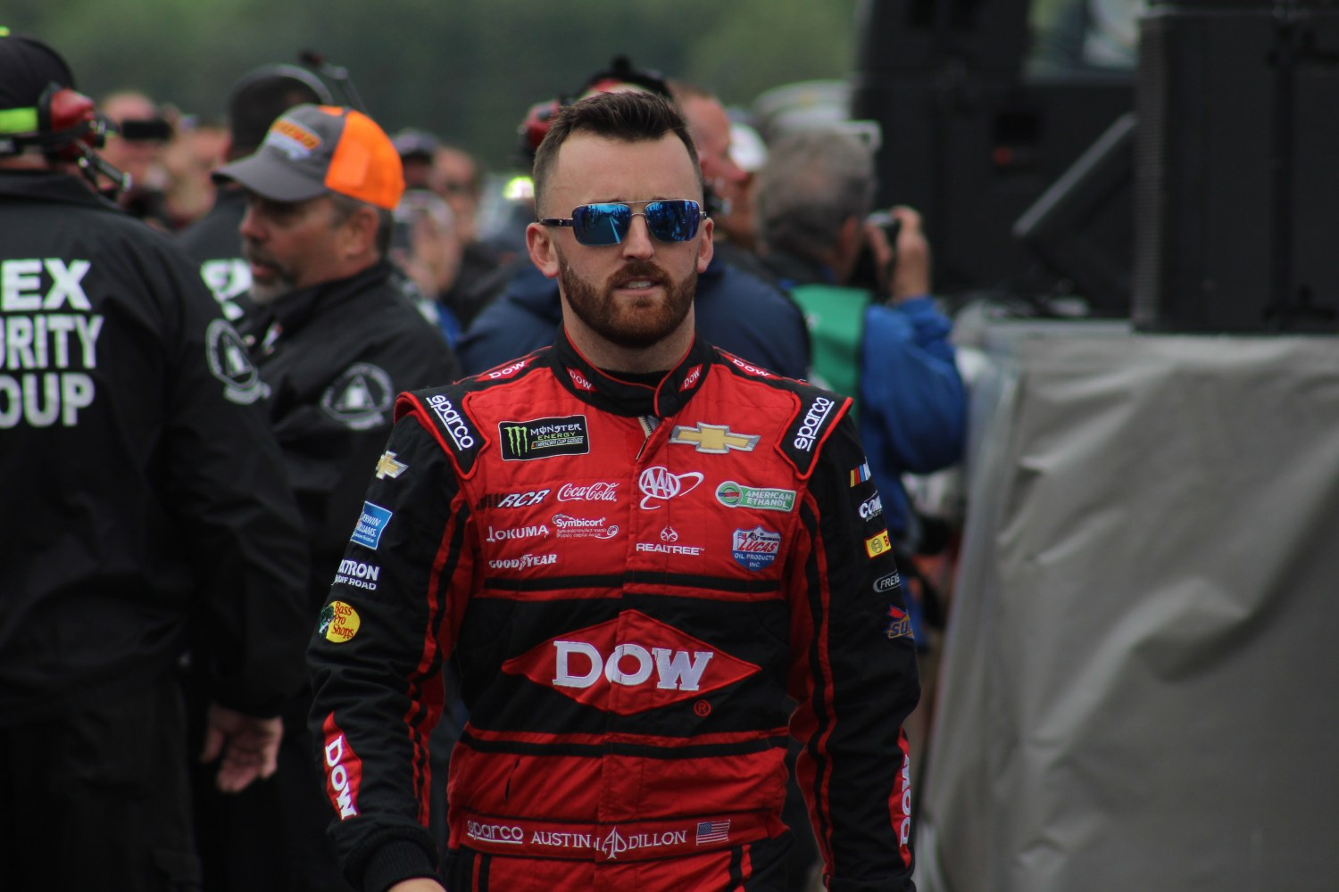 Austin Dillon walks during driver introductions for the 2018 Pocono 400. (Tyler Head   The Racing Experts)