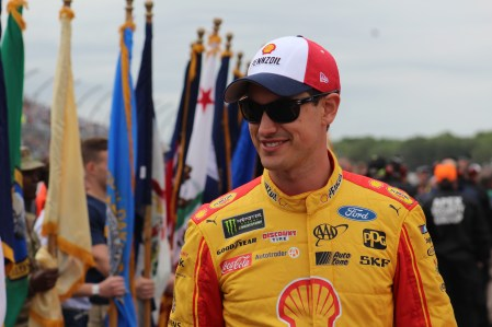 Joey Logano walks during driver introductions for the 2018 Pocono 400. (Tyler Head | The Racing Experts)