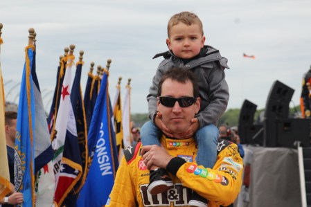 Kyle Busch walks during driver introductions for the 2018 Pocono 400. (Tyler Head | The Racing Experts)