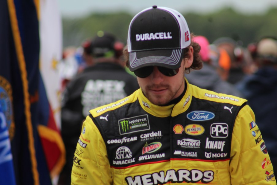 Ryan Blaney walks during driver introductions for the 2018 Pocono 400. (Tyler Head | The Racing Experts)