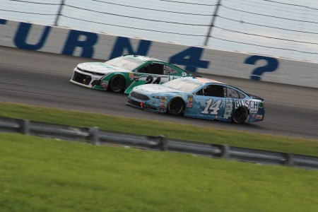 Clint Bowyer (14) and William Byron (24) battle at Pocono.