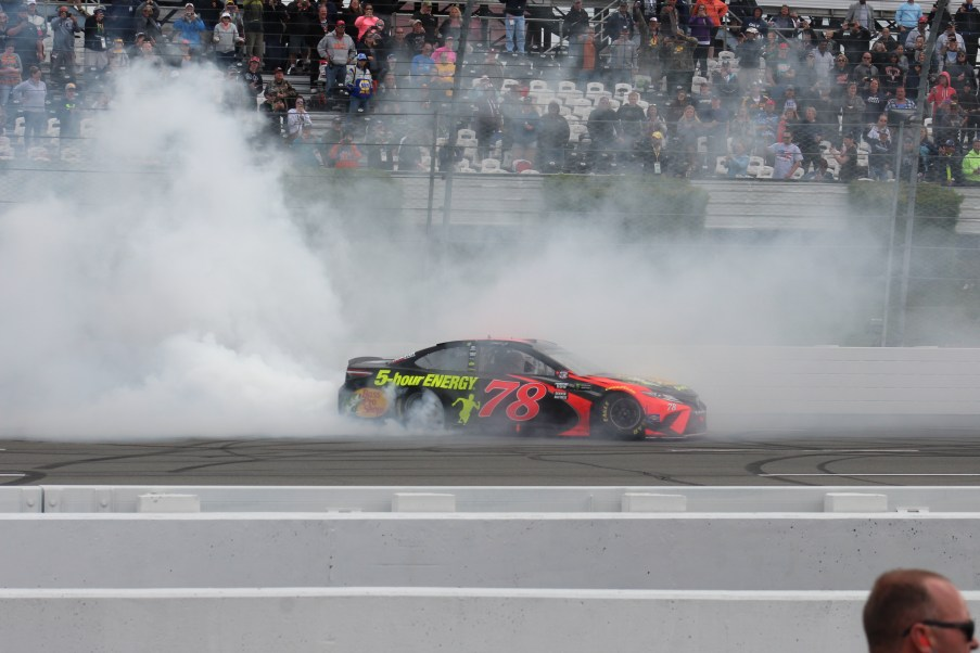 Martin Truex Jr. does a burnout after his victory in the 2018 Pocono 400. (Tyler Head | The Racing Experts)