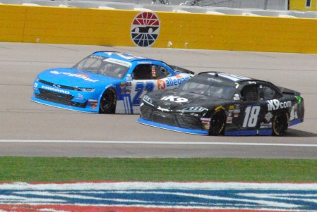 Kyle Busch (18) races John Hunter Nemechek in the 2019 Boyd Gaming 300. Photo by Chris Madrid/The Racing Experts