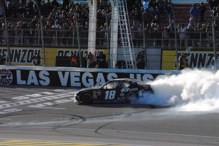 Kyle Busch celebrates his victory in the 2019 Boyd Gaming 300 at Las Vegas Motor Speedway with a burnout along the frontstretch. Photo by Chris Madrid/The Racing Experts.