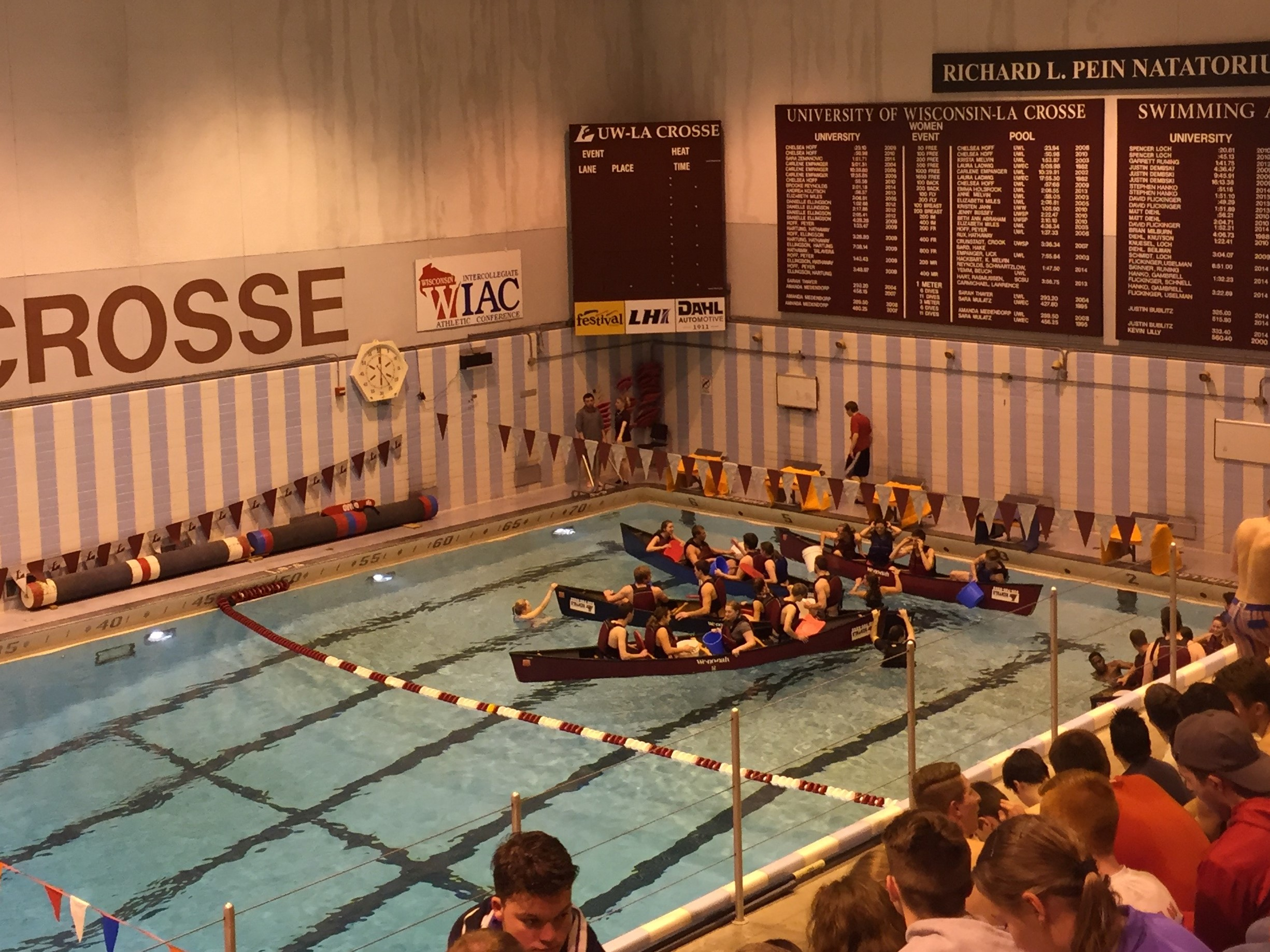 Students try to sink each others' canoes in Mitchell Hall