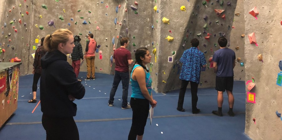 Climbers+plan+their+routes+at+UWL%27s+Back+to+the+80%27s+Bouldering+Competition