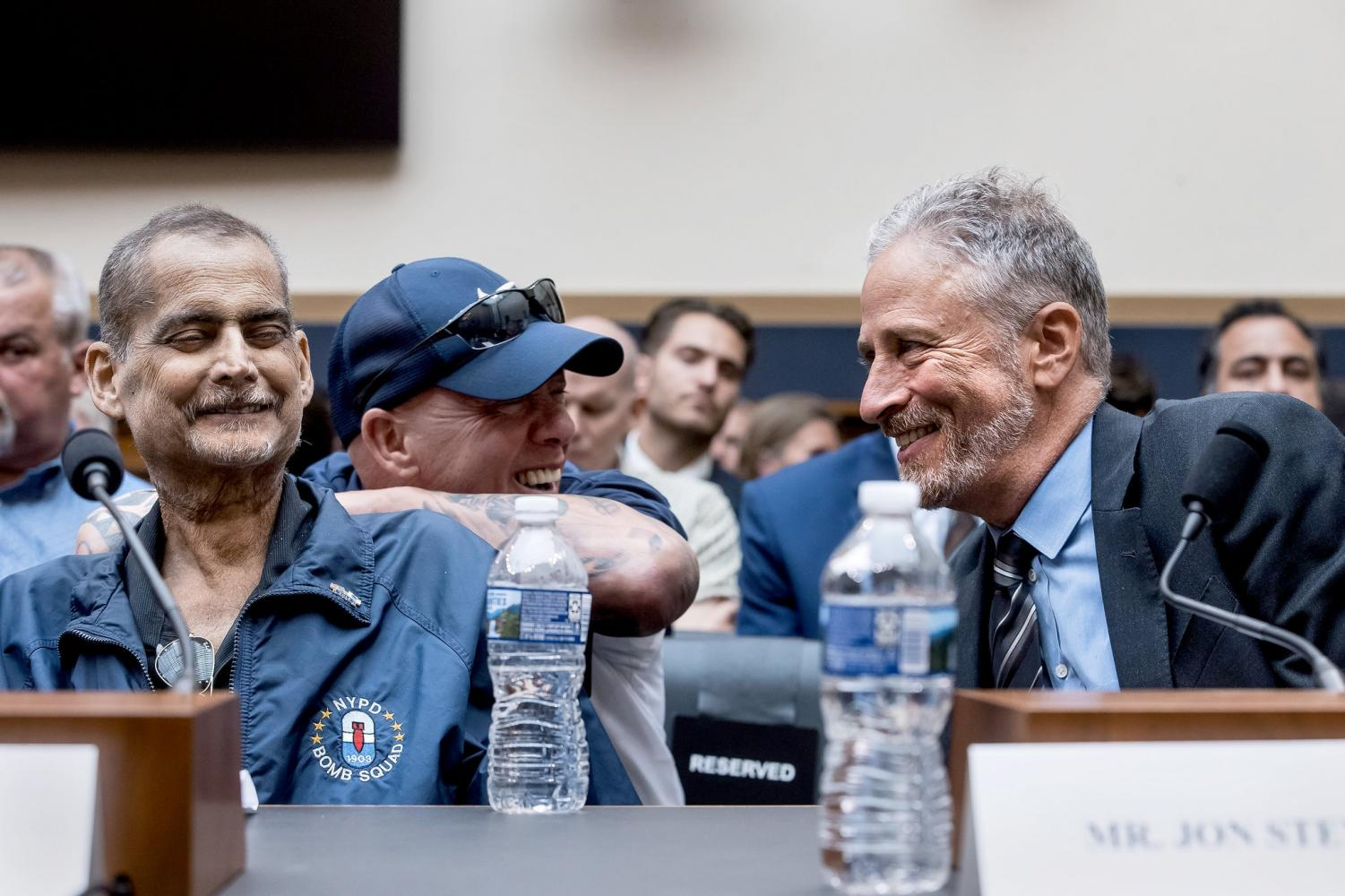 Luis Alvarez (left) and John Stewart (right) at the Congressional hearing for the 9/11 fund. Photo by Zach Gibson.