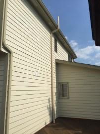 Fan under deck exhasut running above roofline