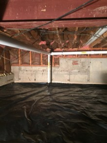 Polyethelene sheeting covering gravel crawlspace