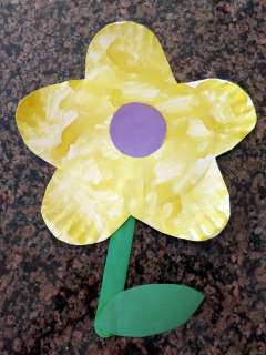 Flower from Toddler Time at Pump It Up. This was the first time Connor filled in something with paint!
