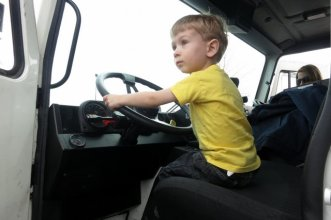 Driving the garbage truck.