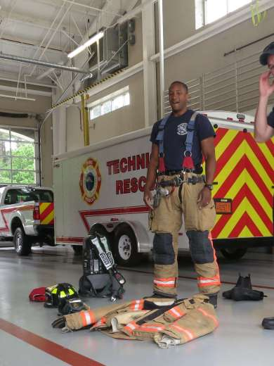 Fire fighters have to put on a lot of gear!