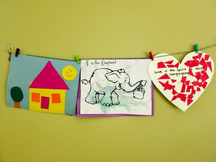 "A house and ""E is for Elephant"" from preschool (E, shapes) and a heart mosaic that reads ""Love is the spirit of this congregation"" from Sunday school."