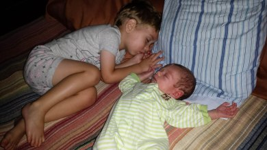 Here I am sleeping next to my baby brother.