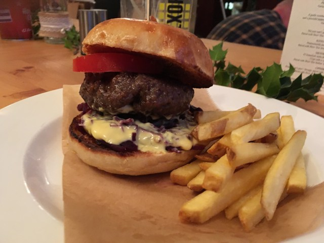 The Railway Venison and Juniper Burger with Mustard Mayo and pickled red cabbage