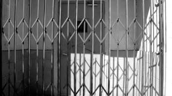 A gated up door on Vermont Avenue forbids any passers-by come near.