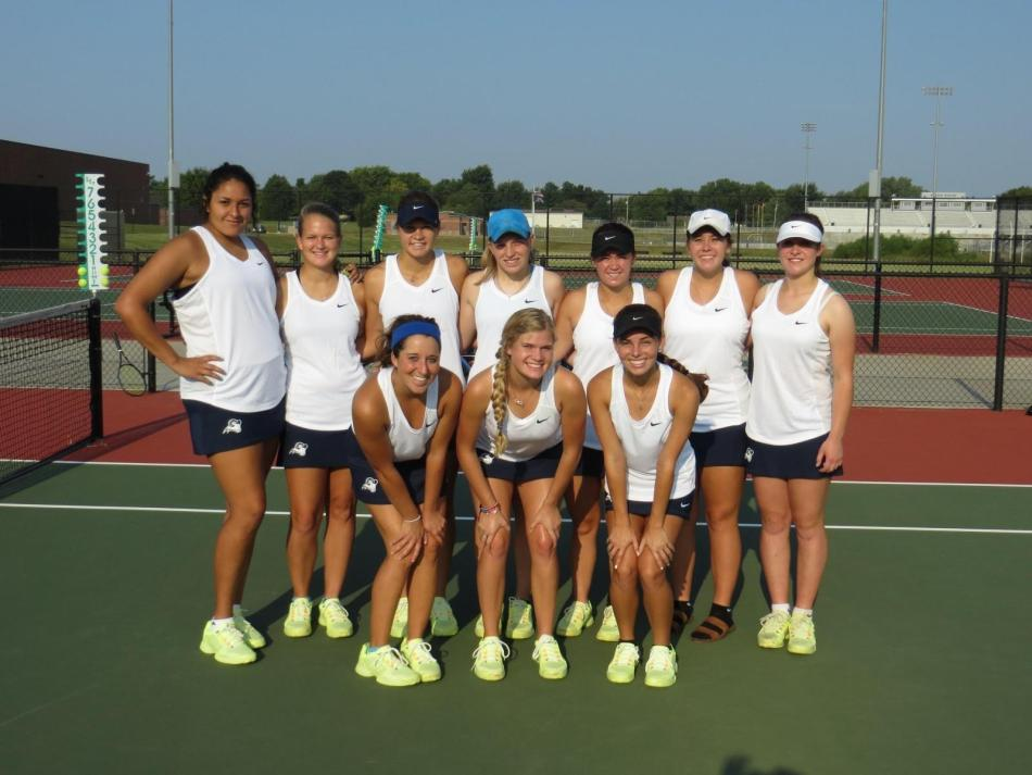 The women's team smiles in victory from winning several matches against Cowley Community College and Southwestern College on Tuesday.