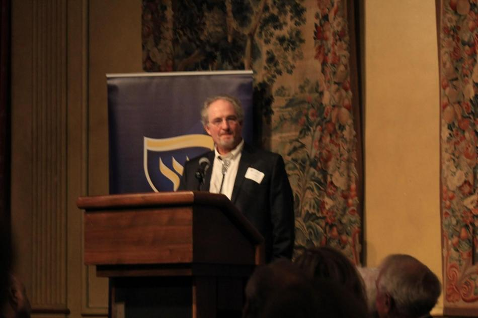 Wesleyan Flame Award winner, Dr. Bruce Benz speaks about his classes at the Alumni Medal Dinner. Photo by Shaydi Paramore