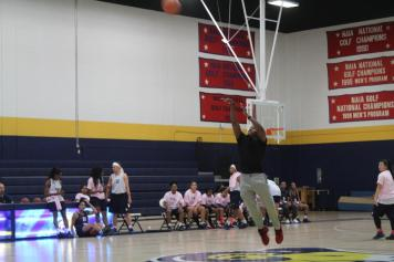 A Midnight Madness participant takes a shot at basket. Photo by Hannah Onder