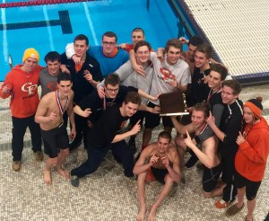 The Prep Swim team celebrates their 14th straight D10 title.
