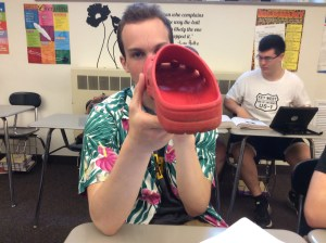 Robby shows the inside of his shoe to prove that it supplies quality arch support.