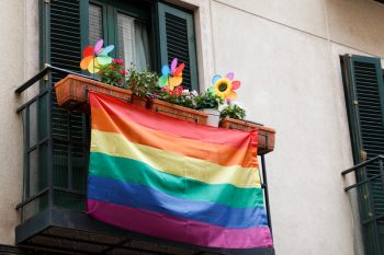 Rainbow banners decorating the streets during gay pride party. This signifies lesbian lesbian couples retreats and online couples retreats for lesbians.