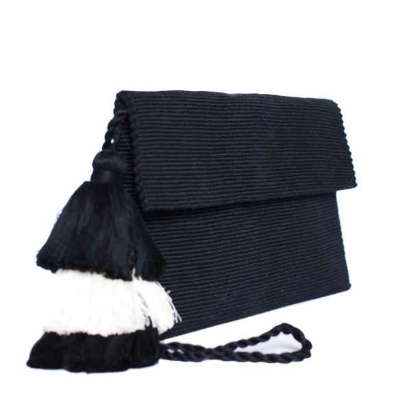 side view black abury cotton clutch bag with tassel