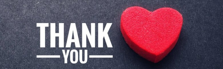 The words thank you and the red heart on the black paper background.