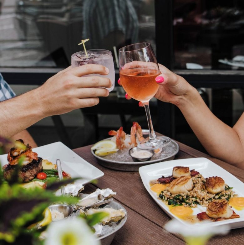 Seafood dishes at Plank's Old Market patio