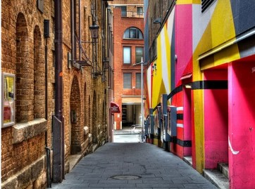 One side of this alley is in a historic district, the other is not.  Can you guess which is which?