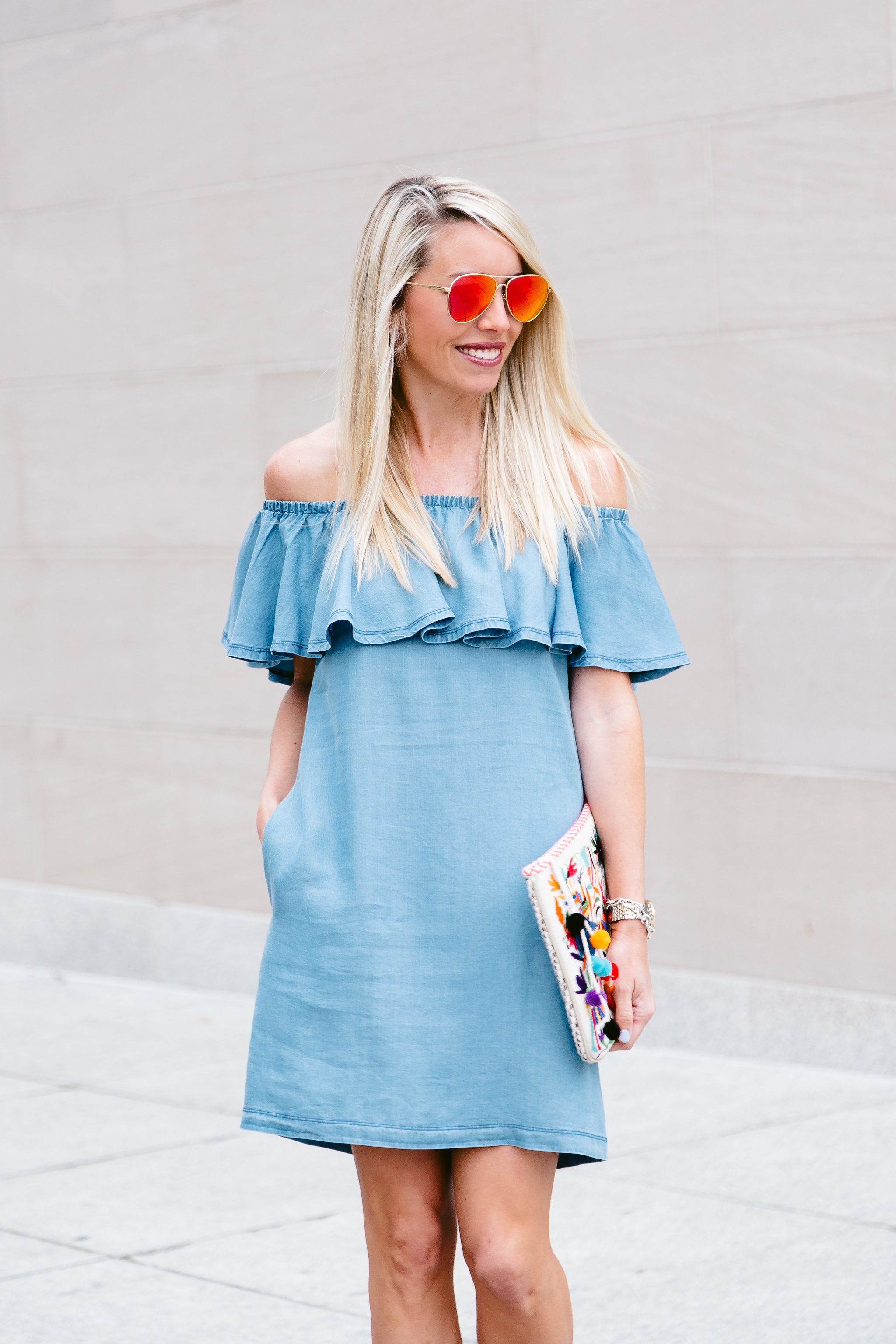 2cebde133b0 denim off the shoulder dress worn with lace-up wedges and printed clutch