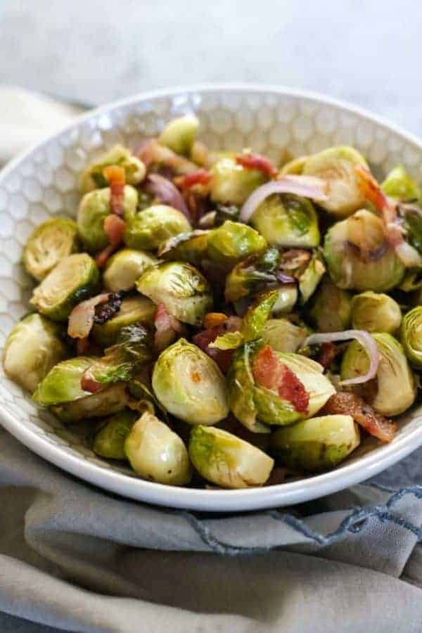 Roasted Brussels Sprouts with Bacon | how to cook brussels sprouts | healthy brussels sprouts recipe | how to roast brussels sprouts | healthy side dish recipes | Whole30 approved recipes | Whole30 side dish recipes | gluten free side dishes | paleo side dishes || The Real Food Dietitians