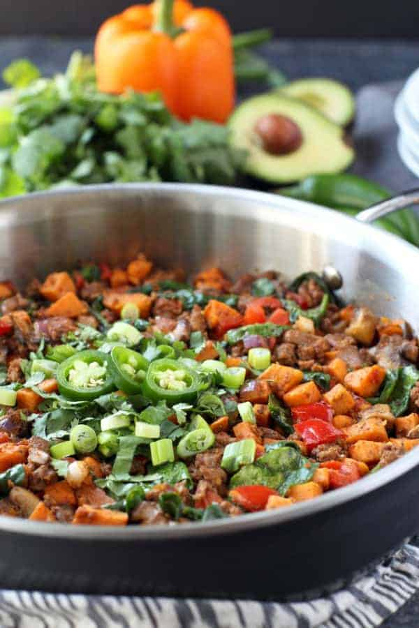 Make good use of taco meat leftovers by giving this easy Sweet Potato Tex Mex Hash recipe a try. A tasty Whole30 and egg-free breakfast option. | whole30 breakfast recipes | whole30 tex mex recipes | gluten-free breakfast recipes | gluten-free tex mex recipes | dairy-free breakfast recipes | dairy-free tex mex recipes | paleo breakfast recipes | paleo tex mex recipes | healthy sweet potato recipes || The Real Food Dietitians