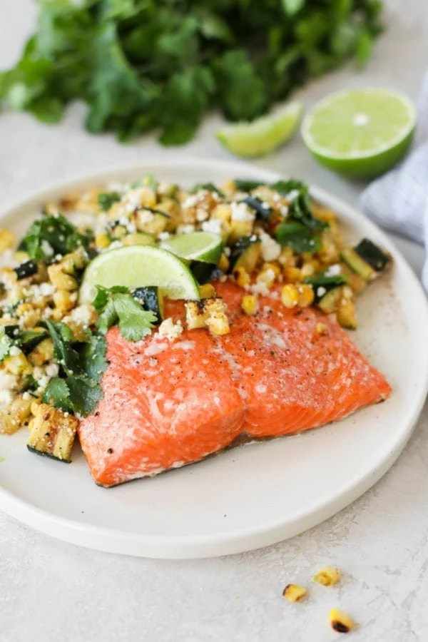 A close up view of Grilled Salmon with Elote Style Veggies that showcases the color and texture of Bristol Bay Sockeye Salmon.