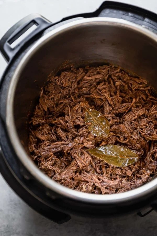 Instant Pot Beef Barbacoa done cooking in the instant pot and ready to be served.